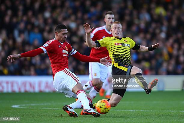Chris Smalling of Manchester United and Ben Watson of Watford compete for the ball during the Barclays Premier League match between Watford and...