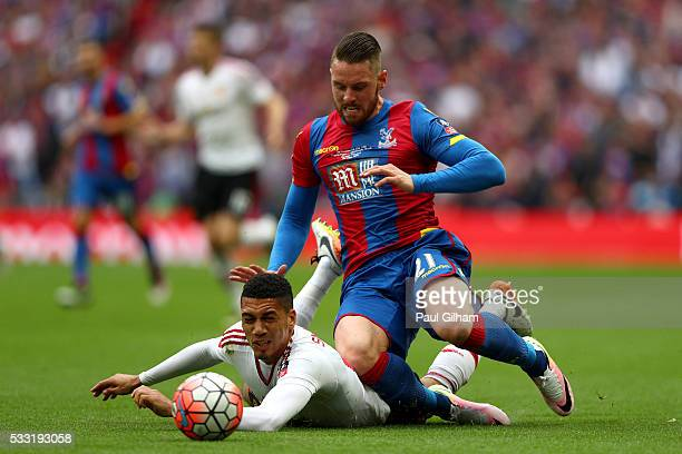 Chris Smalling of Manchester United and Connor Wickham of Crystal Palace battle for the ball during The Emirates FA Cup Final match between...