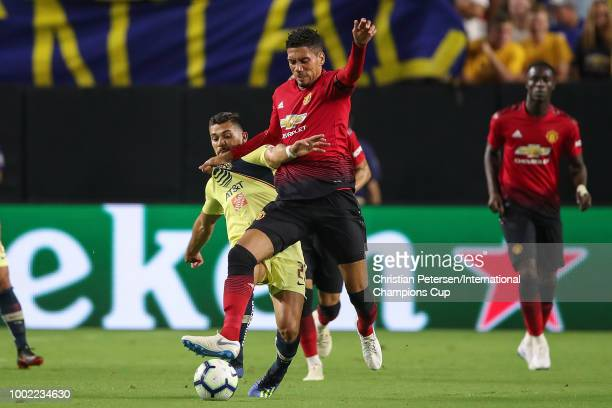 Chris Smalling of Manchester United and Henry Martin of Club America in action during the International Champions Cup game at the University of...