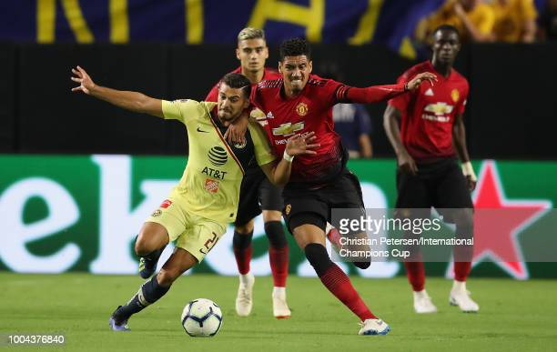 Chris Smalling of Manchester United and Henry Martin of Club America battle for a loose ball during the International Champions Cup game at the...
