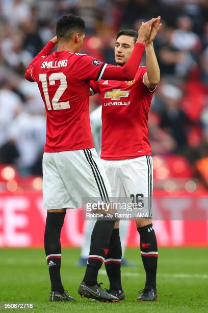 Chris Smalling of Manchester United and Matteo Darmian of Manchester United celebrate at full time during The Emirates FA Cup Semi Final match...