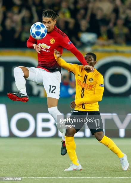 Chris Smalling of Manchester United and Roger Assale of BSC Young Boys battle for the ball during the UEFA Champions League Group H match between BSC...