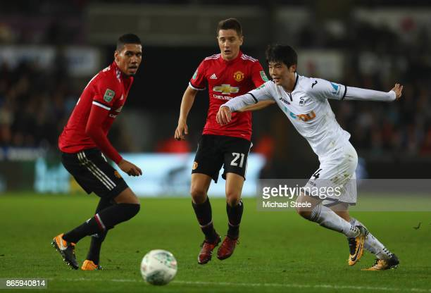 Chris Smalling of Manchester United Ander Herrera of Manchester United and Ki SungYueng of Swansea City in action during the Carabao Cup Fourth Round...