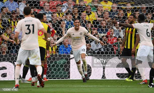 Chris Smalling of Manchester United celebrates after scoring his team's second goal during the Premier League match between Watford FC and Manchester...