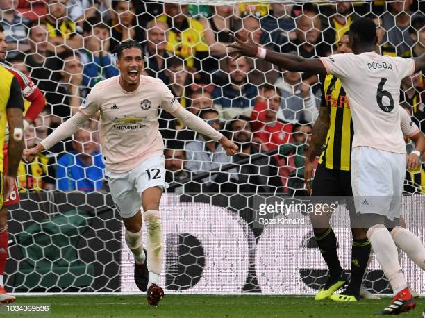 Chris Smalling of Manchester United celebrates after scoring their second goal during the Premier League match between Watford FC and Manchester...