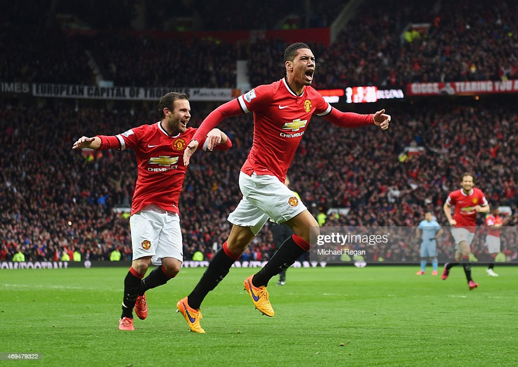 Chris Smalling of Manchester United celebrates as he scores their fourth goal during the Barclays Premier League match between Manchester United and Manchester City at Old Trafford on April 12, 2015 in Manchester, England.