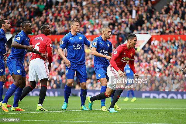 Chris Smalling of Manchester United celebrates scoring his sides first goal during the Premier League match between Manchester United and Leicester...