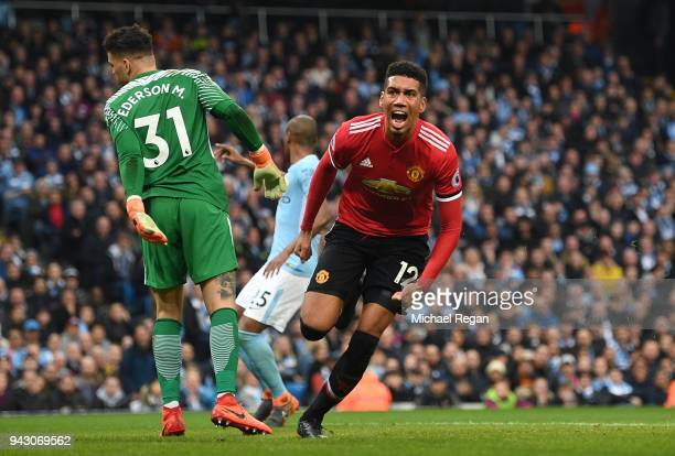 Chris Smalling of Manchester United celebrates scoring his side's third goal during the Premier League match between Manchester City and Manchester...