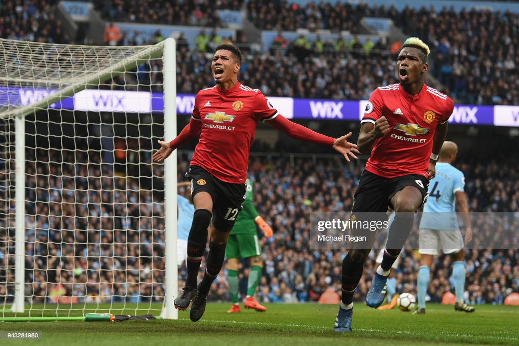 Chris Smalling of Manchester United celebrates scoring his side's third goal with Paul Pogba during the Premier League match between Manchester City and Manchester United at Etihad Stadium on April 7, 2018 in Manchester, England.