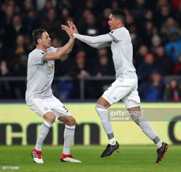 Chris Smalling of Manchester United celebrates scoring the first Manchester United goal with Nemanja Matic during the Premier League match between...