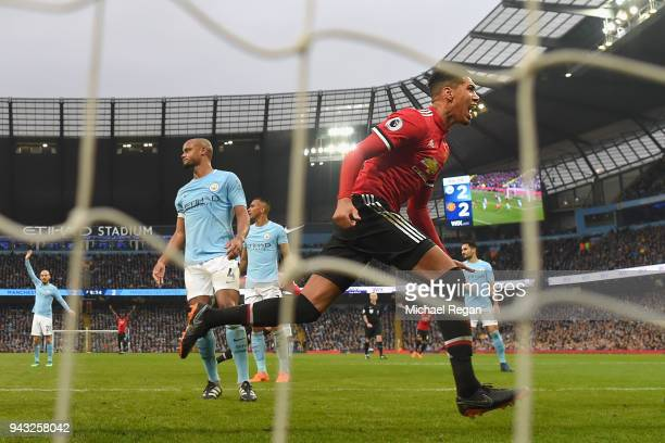 Chris Smalling of Manchester United celebrates scoring the winning goal to make it 32 as Vincent Kompany of Manchester City looks on during the...