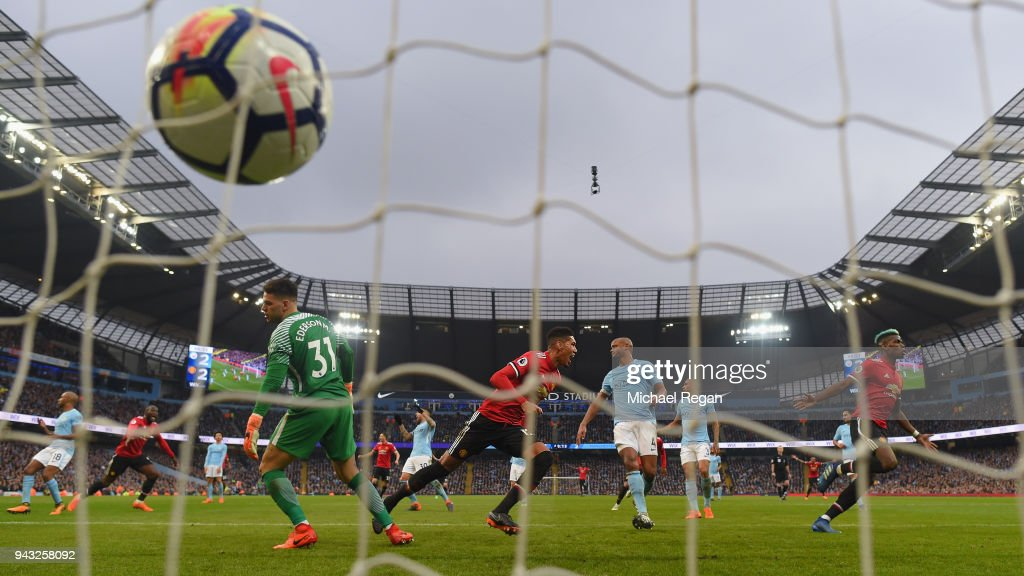Chris Smalling of Manchester United celebrates scoring the winning goal to make it 3-2 as Vincent Kompany of Manchester City looks on during the Premier League match between Manchester City and Manchester United at Etihad Stadium on April 7, 2018 in Manchester, England.