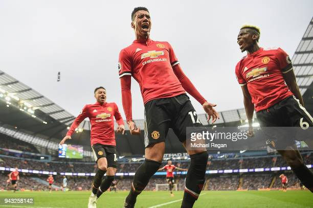 Chris Smalling of Manchester United celebrates scoring the winning goal to make it 32 during the Premier League match between Manchester City and...