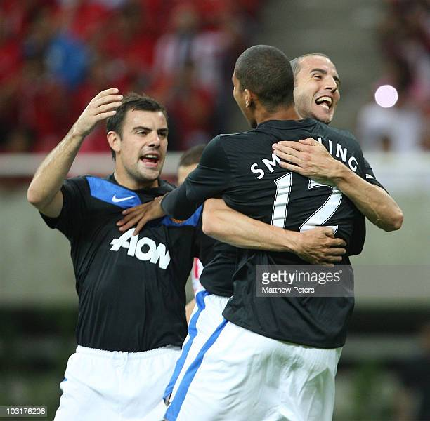 Chris Smalling of Manchester United celebrates scoring their first goal with Darron Gibson and John O'Shea during the preseason friendly match...