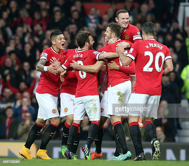 Chris Smalling of Manchester United celebrates scoring their first goal during the Barclays Premier League match between Manchester United and Hull...