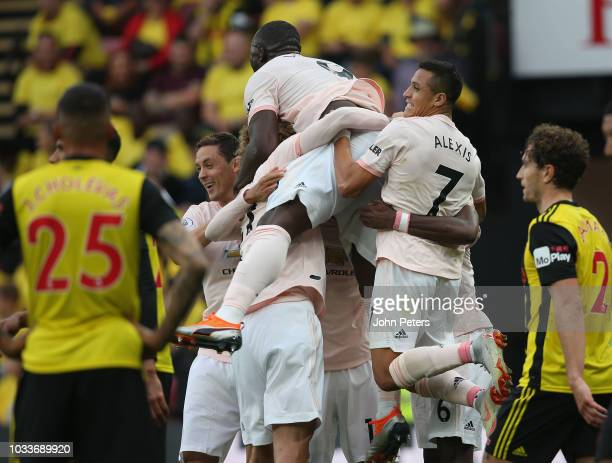 Chris Smalling of Manchester United celebrates scoring their second goal during the Premier League match between Watford FC and Manchester United at...