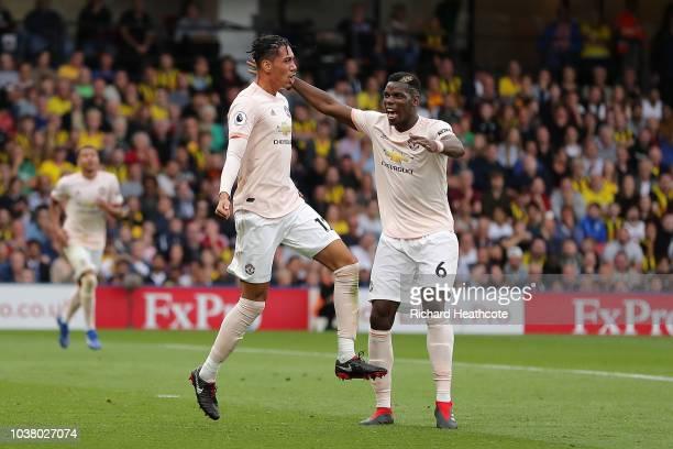 Chris Smalling of Manchester United celebrates scoring their second goal with Paul Pogba during the Premier League match between Watford FC and...