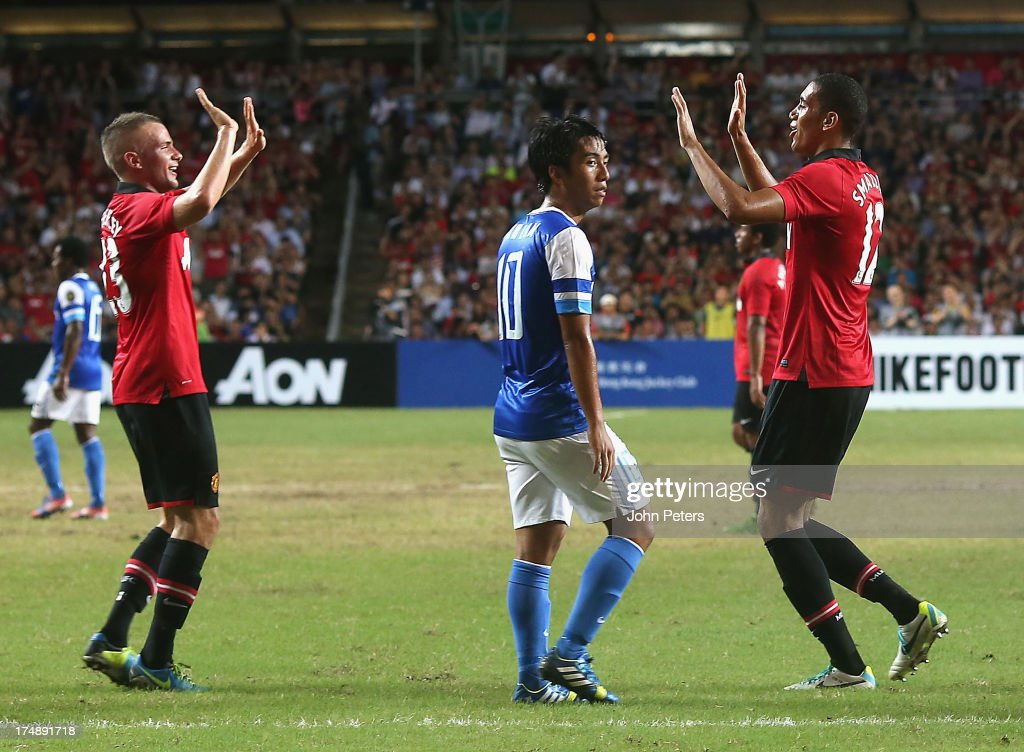Chris Smalling of Manchester United (R) celebrates scoring their second goal during the pre-season friendly match between Kitchee FC and Manchester United as part of their pre-season tour of Bangkok, Australia, Japan and Hong Kong at Hong Kong Stadium on July 29, 2013 in So Kon Po, Hong Kong.