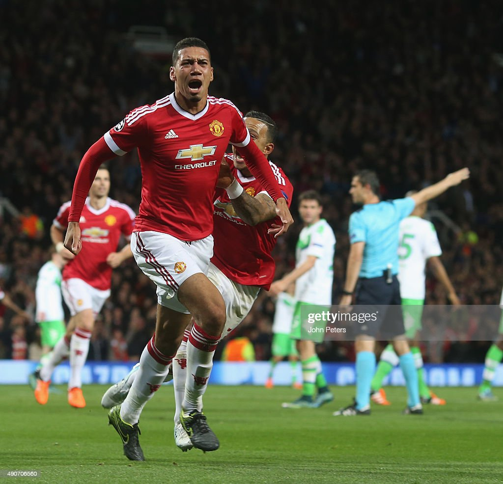 Chris Smalling of Manchester United celebrates scoring their second goal during the UEFA Champions League Group C match between Manchester United and Wolfsburg at Old Trafford on September 30, 2015 in Manchester, United Kingdom.