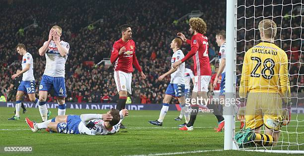 Chris Smalling of Manchester United celebrates scoring their second goal during the Emirates FA Cup Fourth Round match between Manchester United and...