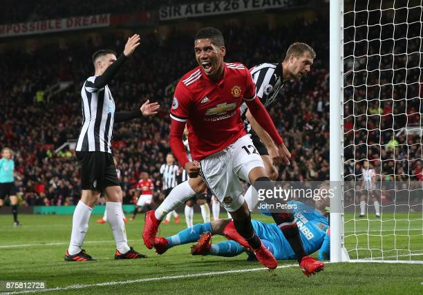 Chris Smalling of Manchester United celebrates scoring their second goal during the Premier League match between Manchester United and Newcastle...