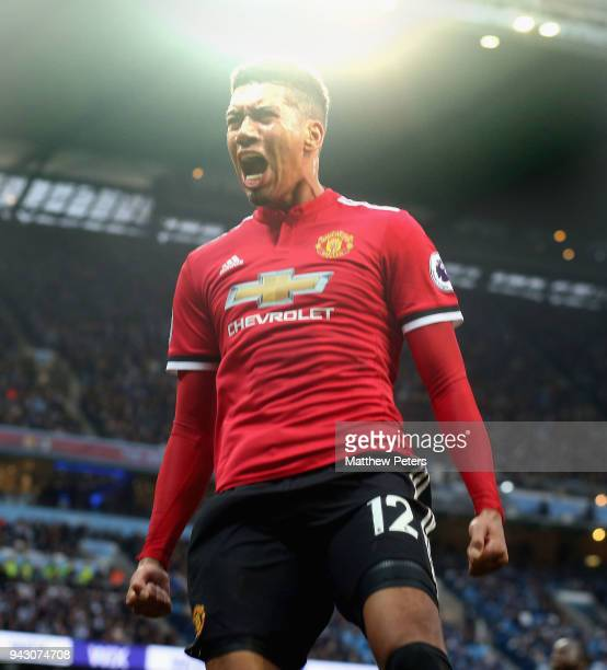 Chris Smalling of Manchester United celebrates scoring their third goal during the Premier League match between Manchester City and Manchester United...
