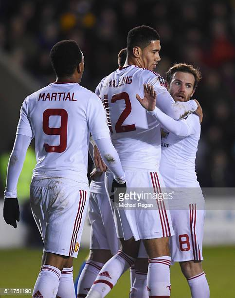 Chris Smalling of Manchester United celebrates with team mates Anthony Martial and Juan Mata as he scores their first goal during the Emirates FA Cup...