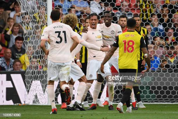Chris Smalling of Manchester United celebrates with teammates after scoring his team's second goal during the Premier League match between Watford FC...
