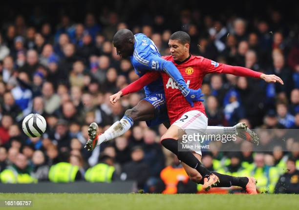Chris Smalling of Manchester United challenges Demba Ba of Chelsea during the FA Cup with Budweiser Sixth Round Replay match between Chelsea and...