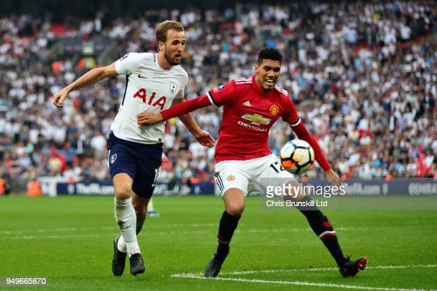 Chris Smalling of Manchester United holds off Harry Kane of Tottenham Hotspur during The Emirates FA Cup Semi Final match between Manchester United...