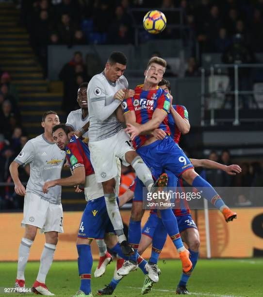 Chris Smalling of Manchester United in action with Alexander Sorloth of Crystal Palace during the Premier League match between Crystal Palace and...