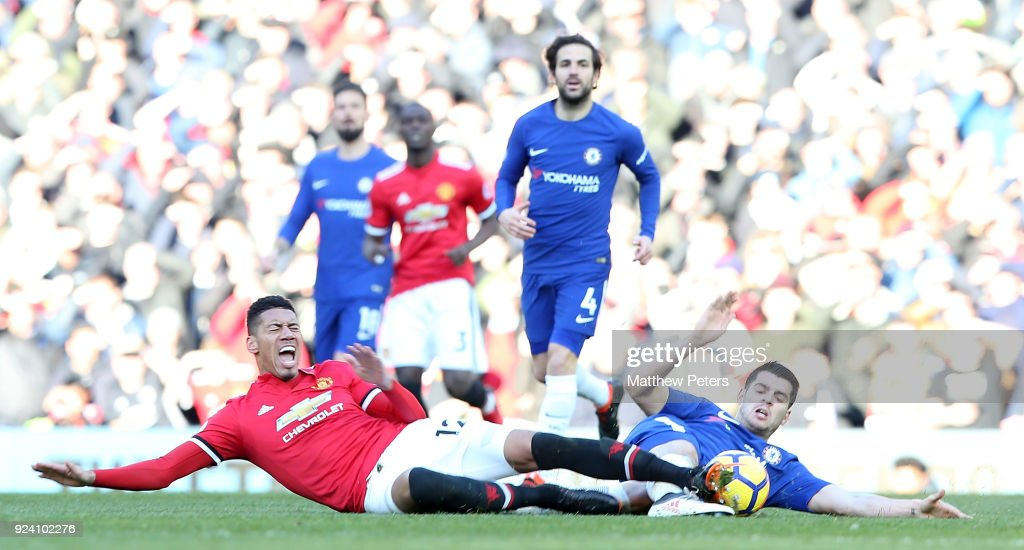 Chris Smalling of Manchester United in action with Alvaro Morata of Chelsea during the Premier League match between Manchester United and Chelsea at Old Trafford on February 25, 2018 in Manchester, England.