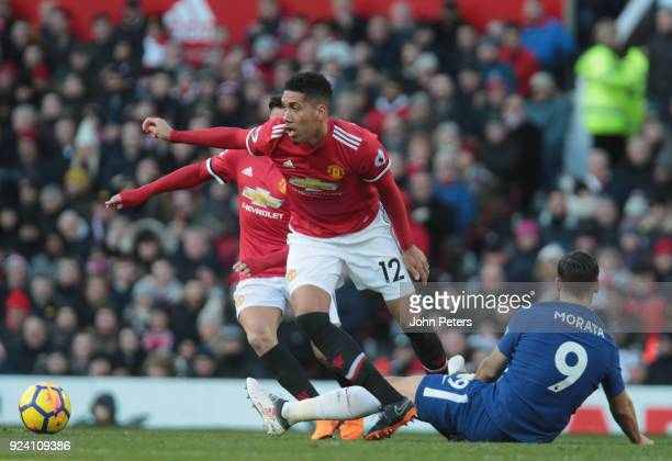 Chris Smalling of Manchester United in action with Alvaro Morata of Chelsea during the Premier League match between Manchester United and Chelsea at...