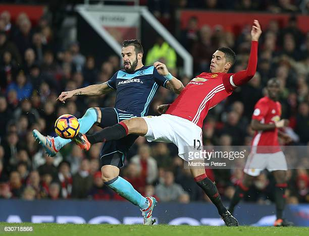Chris Smalling of Manchester United in action with Alvaro Negredo of Middlesbrough during the Premier League match between Manchester United and...