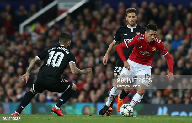 Chris Smalling of Manchester United in action with Ever Banega of Sevilla FC during the UEFA Champions League Round of 16 Second Leg match between...