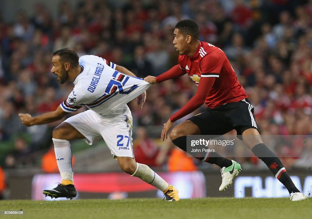 Chris Smalling of Manchester United in action with Fabio Quagliarella of Sampdoria during the International Champions Cup pre-season friendly match between Manchester United and Sampdoria at the Aviva Stadium on August 2, 2017 in Dublin, Ireland.