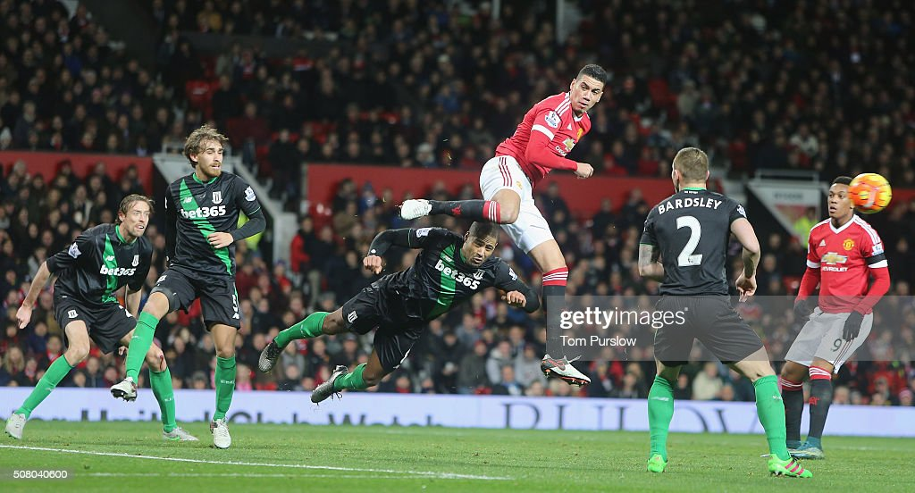 Chris Smalling of Manchester United in action with Glen Johnson of Stoke City during the Barclays Premier League match between Manchester United and Stoke City at Old Trafford on February 2, 2016 in Manchester, England.