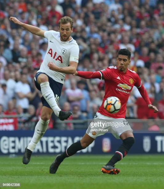 Chris Smalling of Manchester United in action with Harry Kane of Tottenham Hotspur during the Emirates FA Cup semifinal match between Manchester...