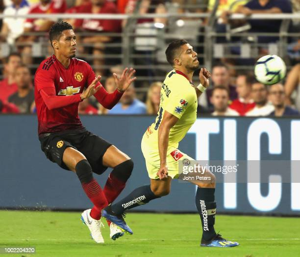 Chris Smalling of Manchester United in action with Henry Martin of Club America during the preseason friendly match between Manchester United and...