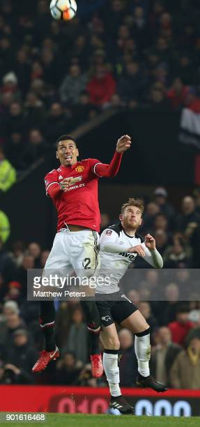 Chris Smalling of Manchester United in action with Johnny Russell of Derby County during the Emirates FA Cup Third Round match between Manchester...