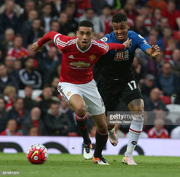 Chris Smalling of Manchester United in action with Joshua King of AFC Bournemouth during the Barclays Premier League match between Manchester United...