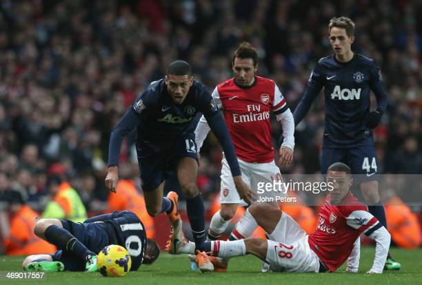 Chris Smalling of Manchester United in action with Kieran Gibbs of Arsenal during the Barclays Premier League match between Arsenal and Manchester...