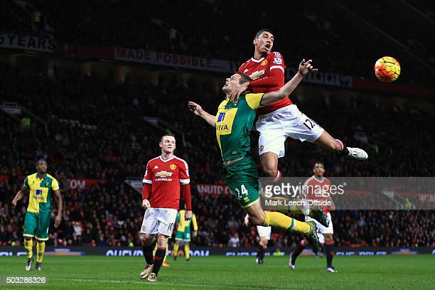 Chris Smalling of Manchester United in action with Ryan Bennett of Norwich City during the Barclays Premier League match between Manchester United...