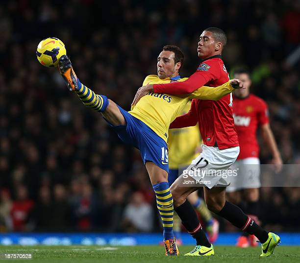 Chris Smalling of Manchester United in action with Santi Cazorla of Arsenal the Barclays Premier League Match between Manchester United and Arsenal...