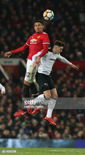 Chris Smalling of Manchester United in action with Tom Lawrence of Derby County during the Emirates FA Cup Third Round match between Manchester...