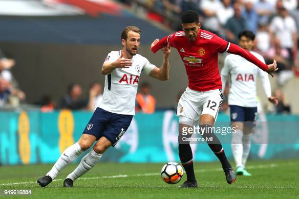 Chris Smalling of Manchester United is challenged by Harry Kane of Tottenham Hotspur during The Emirates FA Cup Semi Final match between Manchester...