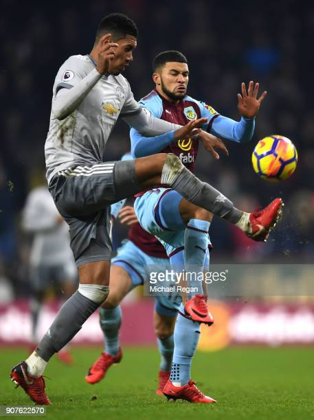 Chris Smalling of Manchester United is challenged by Nahki Wells of Burnley during the Premier League match between Burnley and Manchester United at...