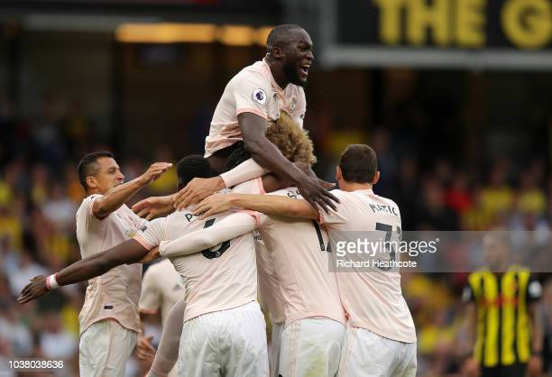 Chris Smalling of Manchester United is mobbed by his team mates after scoring their second goal during the Premier League match between Watford FC...