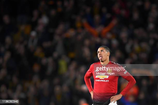 Chris Smalling of Manchester United looks dejected after the FA Cup Quarter Final match between Wolverhampton Wanderers and Manchester United at...