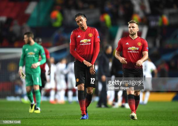 Chris Smalling of Manchester United looks dejected following his sides defeat in the Group H match of the UEFA Champions League between Manchester...